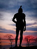 Squanto overlooking Plymouth Harbor at sunrise.