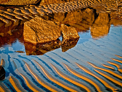 What I like about this image is how the shadows go in one direction and the reflections in the other.  I had so much fun shooting my way around this beach. No matter which way I turned, there was something I wanted to make sure I captured. I spent about a half hour shooting just this one little cove created by a rock wall. This is a 5 shot hdr. The hardest thing about shooting this little scene was keeping my shadow out of it!